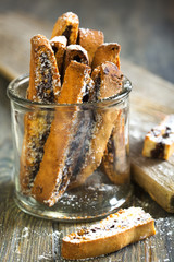 Biscotti with chocolate in a glass jar.
