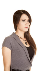 woman in a gray dress serious side close