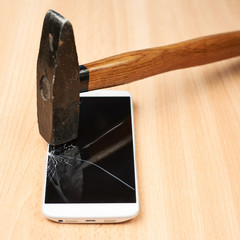 Composition of hammer and a broken phone