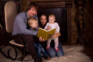 family on a fluffy carpet by the fireplace
