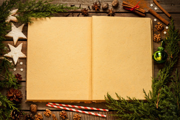 Old blank opened book with christmas decorations around