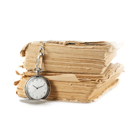 Pocket watch on the old book