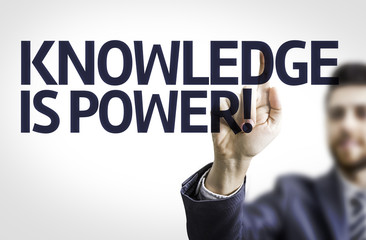 Business man pointing the text: Knowledge is Power