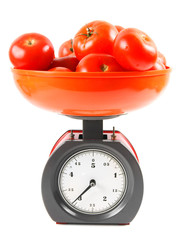 Tomatoes on scales. On white background.