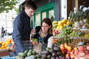 Couple shopping at a vegetable store