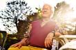 anziano seduto in giardino al tramonto - 70271443