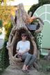 Woman on a stump