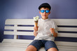 Cute six years boy eating ice cream