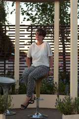 Woman on a bar stool