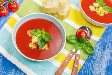 Delicious tomato soup. Tomato soup with basil in a bowl