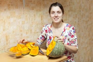 Woman cooks pumpkin