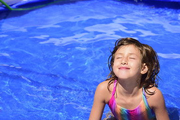 Happy child relaxing in the pool