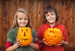 Kids with Halloween pumpkin jack-o-lanterns