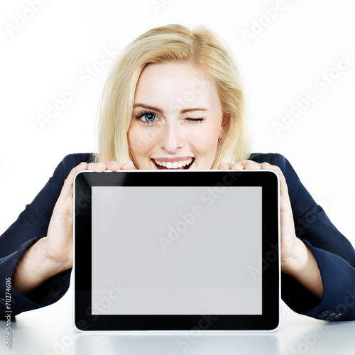 canvas print picture Woman winking over her tablet pc with copyspace