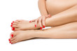 female foots with red pedicure and hands with red manicure