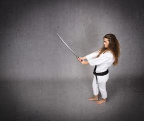 martial art expert with katana on hand