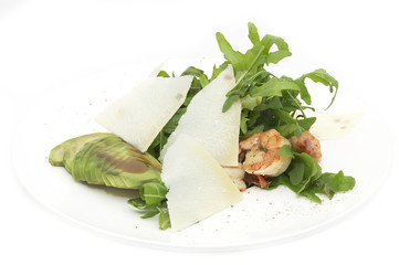 shrimp with arugula on a plate on a white background