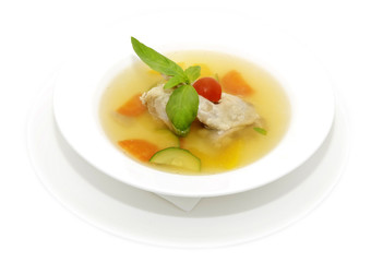 quail broth with vegetables decorated with mint