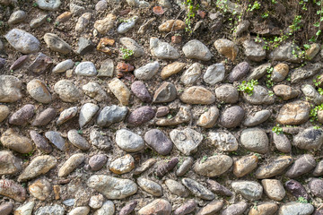 Italian old wall built with river stones