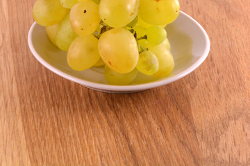 A close-up of grapes on white table