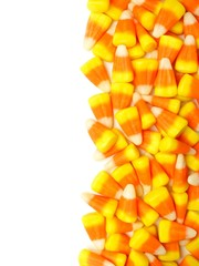 Halloween candy corn vertical border over white