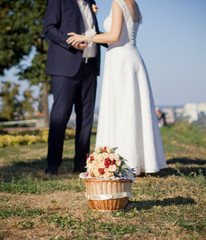 Bride and groom on a hill, with bridal bouquet