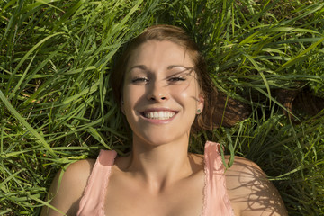 Happy woman relaxing in meadow