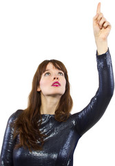 stylish female model in shiny dress with pointing gestures