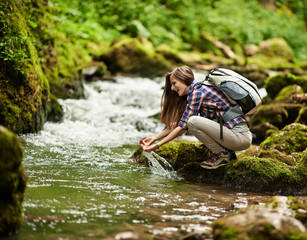 Young woman hiker by the river