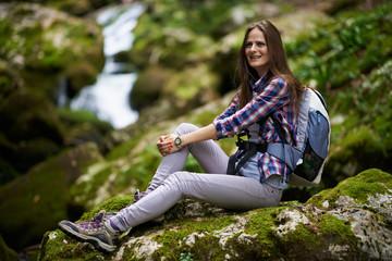 Woman hiker resting on rocks