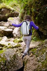 Hiker lady with backpack on trail