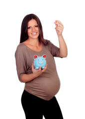 Beautiful pregnant woman with a blue moneybox