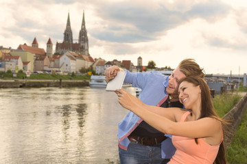 Happy young couple doing a selfie