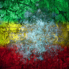Red, yellow, green rasta flag on Concrete wall
