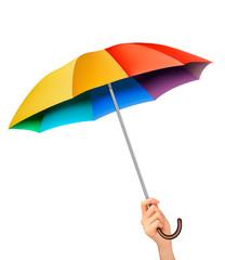 Hand with a rainbow umbrella. Vector.