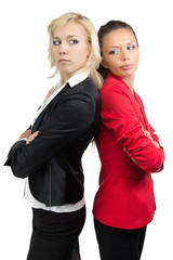 Two businesswoman standing back-to-back