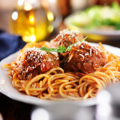 italian spaghetti and meatballs with salad in background