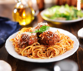 italian food - spaghetti and meatballs at dinner table