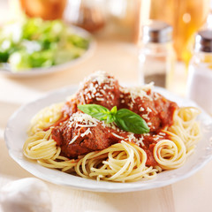 spaghetti and meatball dinner with salad