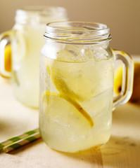 jar of fresh homemade lemonade on wood table