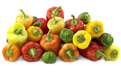Pile of colorful peppers isolated