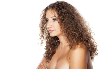 side view of a calm and smiling young woman with curly hair