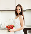 young woman with  plate of strawberries