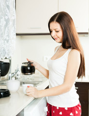 Brunette  with  coffee maker