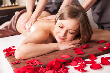 Young woman having massage in beauty spa.