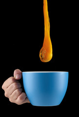 Egg Yolk dripping in to cup.
