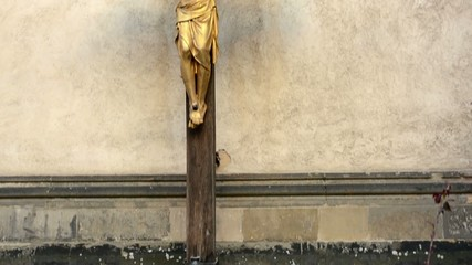 jesus on the cross - crucifix - wall and candles
