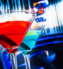 blue and red cocktail in lounge bar background