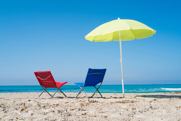 Beach umbrella and lounge chairs