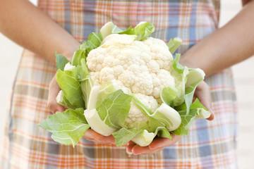 Cauliflower in woman's hands